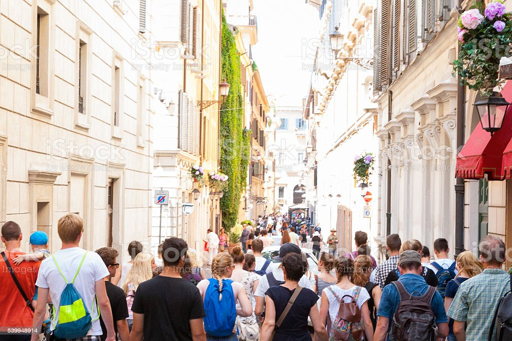 Tourists walking the downtown streets of Rome, Italy stock photo