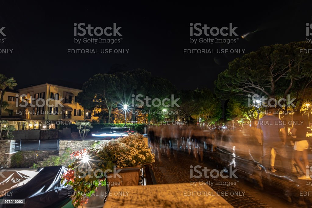 Tourists walking the streets of ancient Sirmione on Lake Garda, Italy stock photo