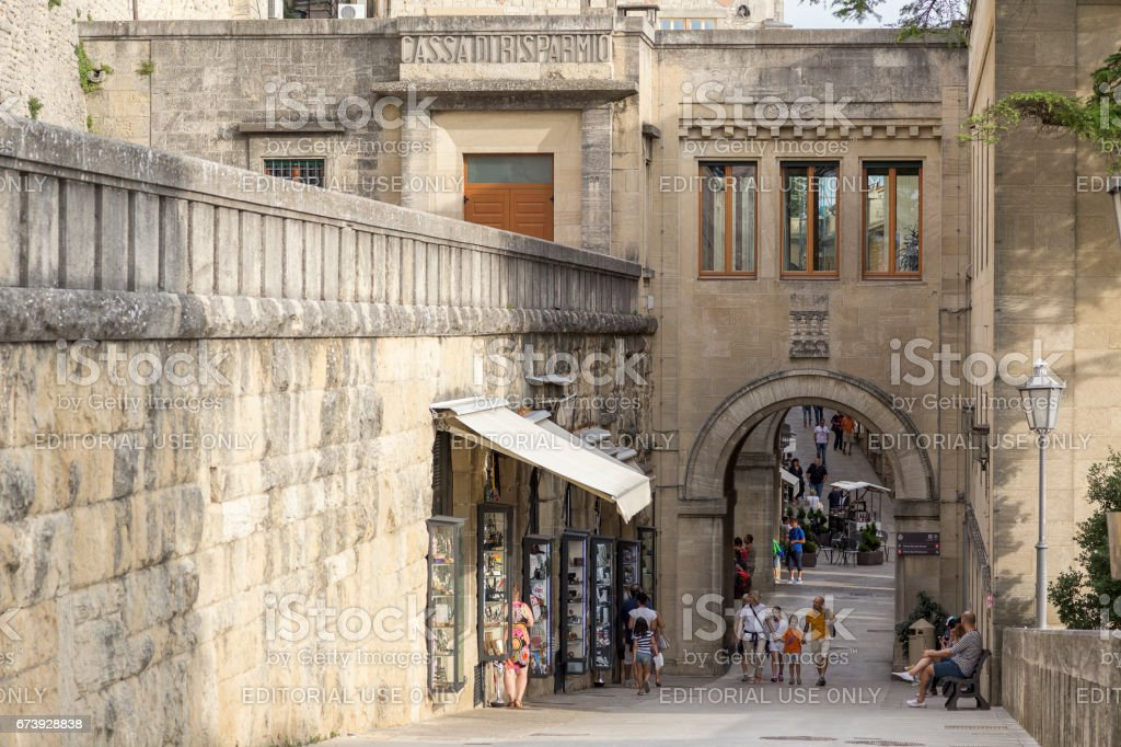 City of San Marino, San Marino - August 22, 2014: Tourists walking through the steep medieval streets of the captial city. stock photo