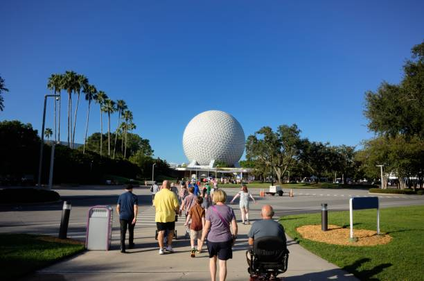 Tourists walking toward Epcot entrance stock photo