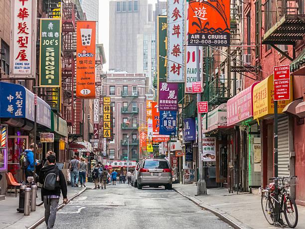 Tourists walks through Chinatown street, NY stock photo