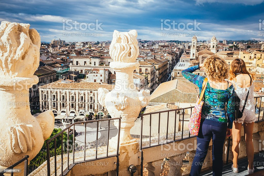 Tourists watching the panorama of the city of Catania stock photo