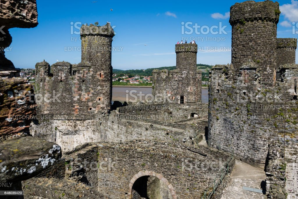 Tourists watching the river from a tower of Conwy Castle stock photo