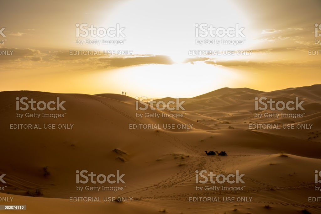 Tourists Watching The Sun Set at Erg Chebbi stock photo