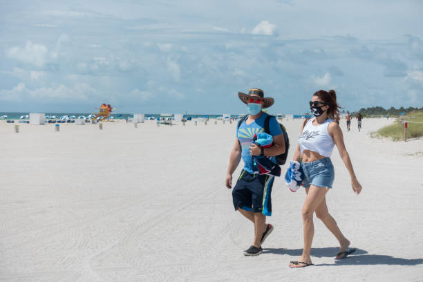 Tourists wear protective face masks in Miami Beach, Florida stock photo