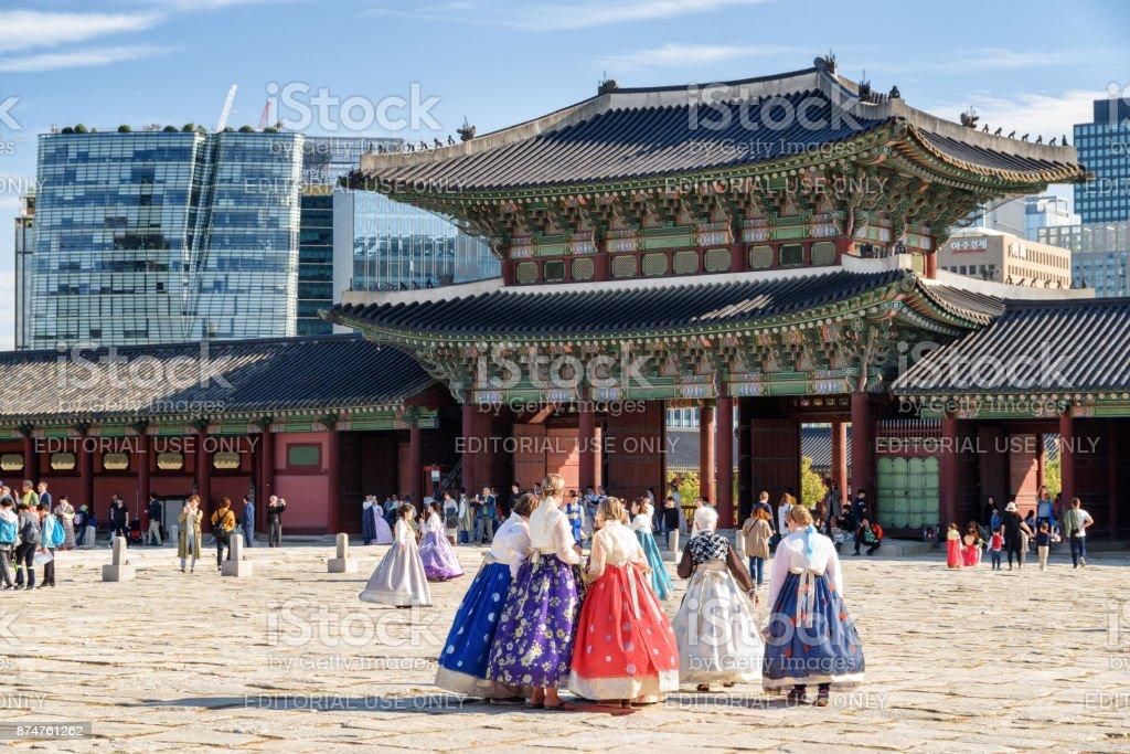 Tourists wearing Korean traditional dress Hanbok, Gyeongbokgung stock photo