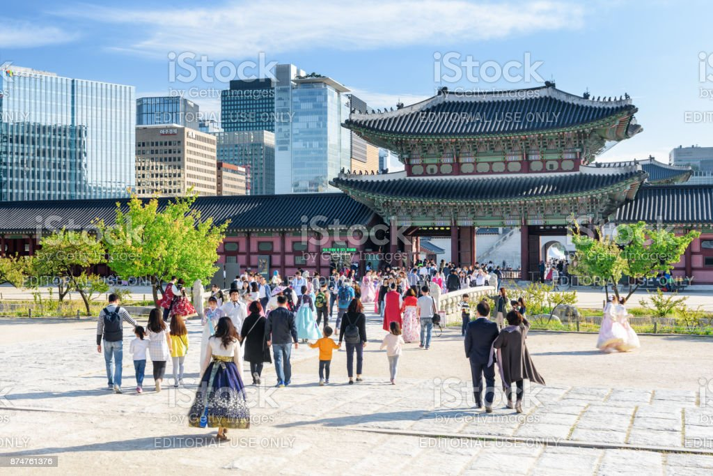 Tourists wearing Korean traditional dress in Gyeongbokgung stock photo