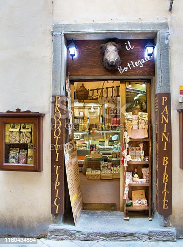 The old town of Volterra of the Province of Pisa, Italy. A wine and gift shop store front on the tourist shopping street of the popular tourist destination city.