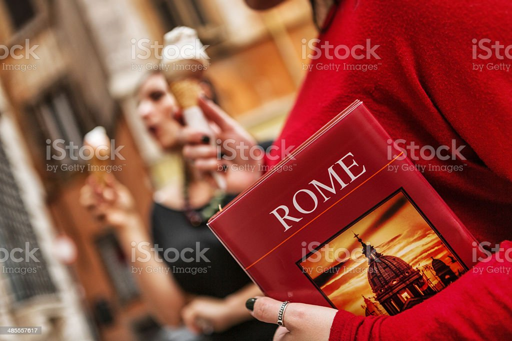 Tourists with a guide eating icecream in Rome stock photo