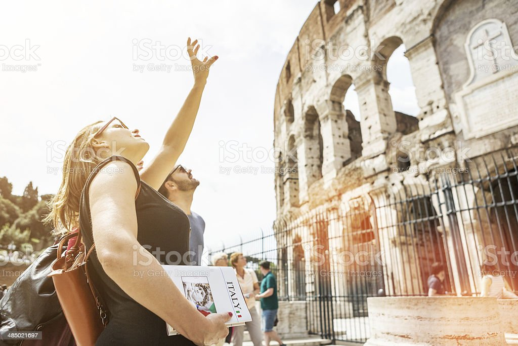 Tourists with a guide in front of the Coliseum, Rome Tourists with a guide in front of the Coliseum, Rome Adult Stock Photo