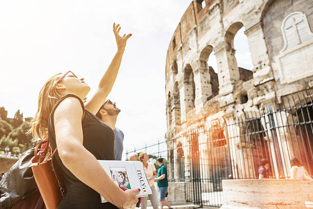 Tourists with a guide in front of the Coliseum, Rome stock photo