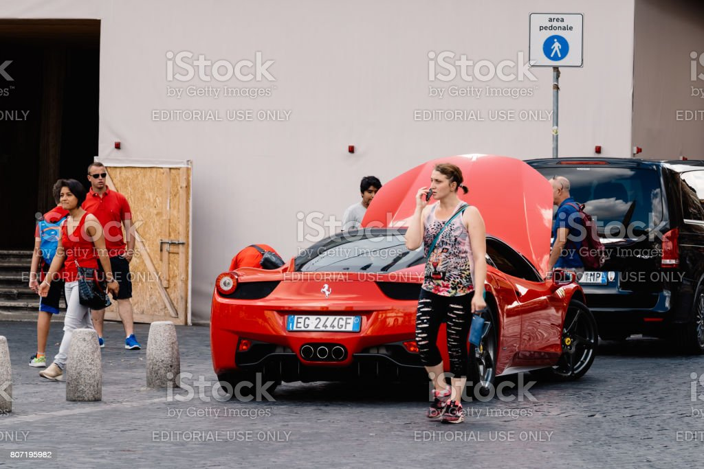 Tourists with luxury sport car for rental stock photo