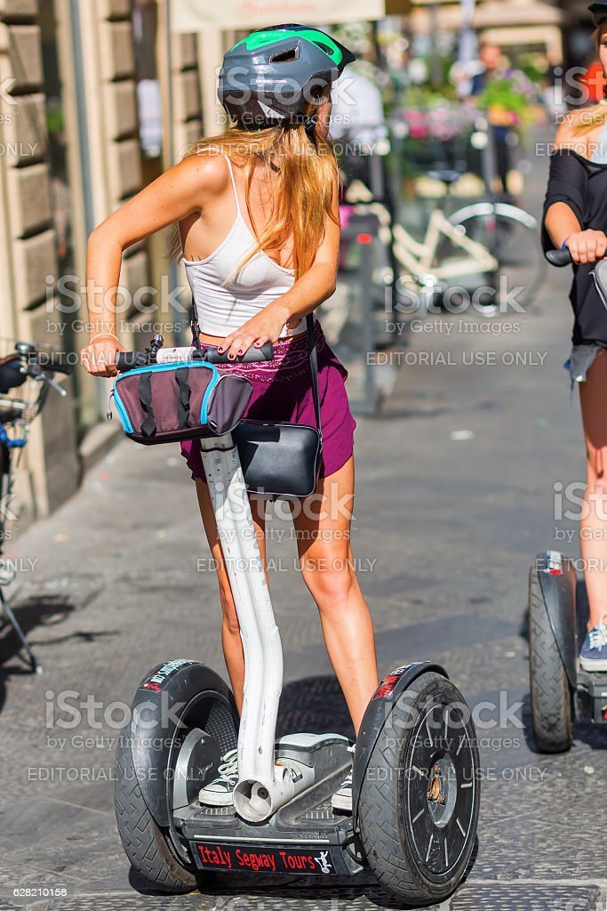 tourists with Segway in Florence, Italy stock photo