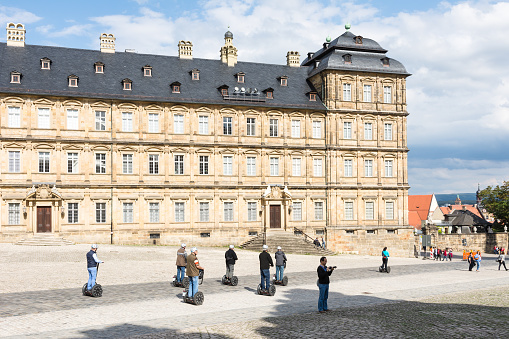 Tourists with segways at Neue Residenz in Bamberg