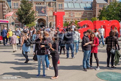 Amsterdam, Netherlands - sep 03, 2017 : Tourists with selfie stick on the museum square in Amsterdam