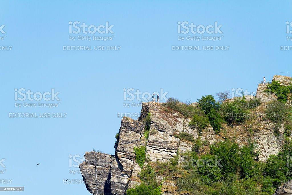 Tourits on rock Loreley at Rhine stock photo