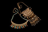 istock Tow Pair Of Beautiful Bohemian Style Beaded Necklaces Hand Crafted From Semi Precious Stones And Gold Metal Isolated On Black Background 946039810