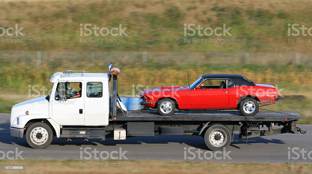 Tow Truck Hauling A New Red Car stock photo