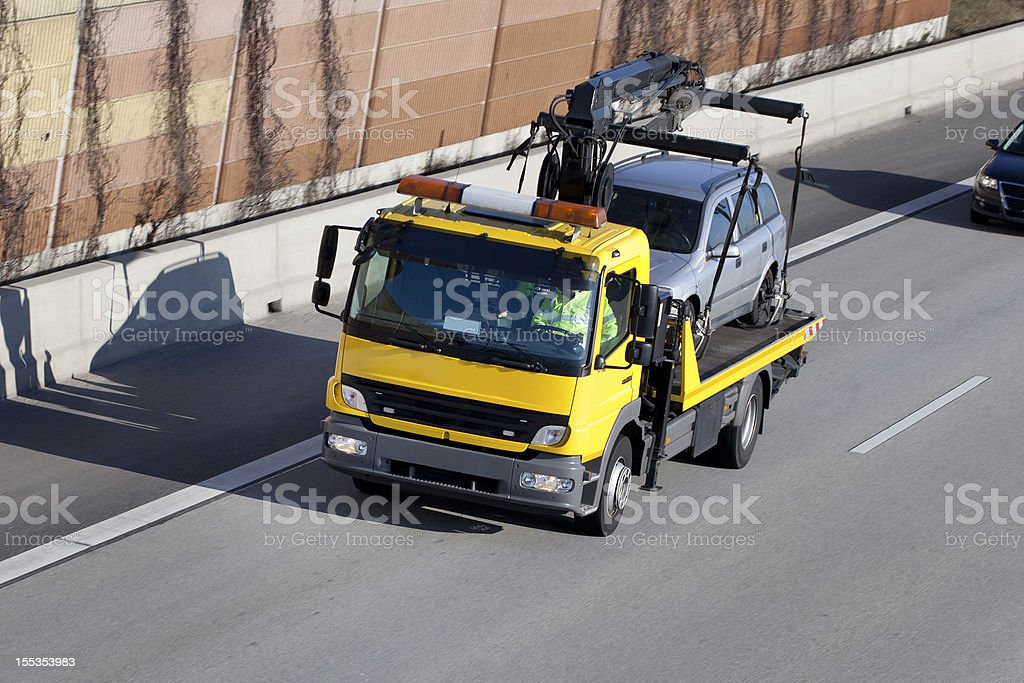 Tow truck on the highway stock photo