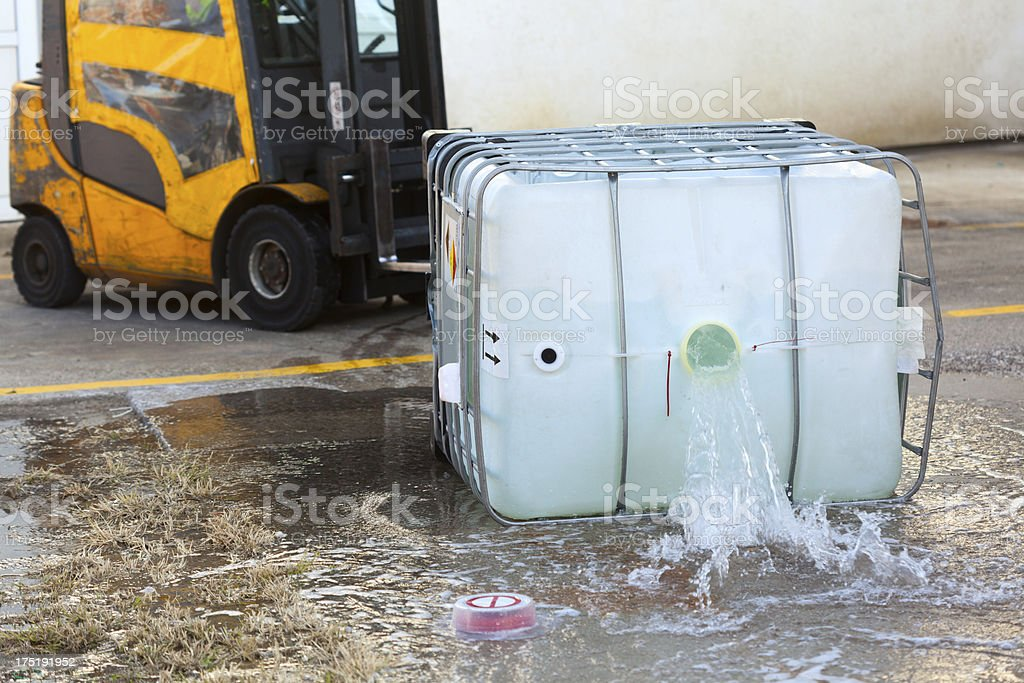 Tow truck spilling dangerous goods from container stock photo