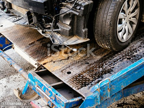 istock Tow truck takes away the car in an accident 1177581045