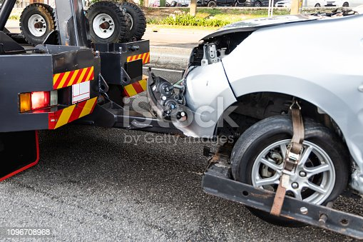istock Tow truck towing broken down car from accident 1096708968