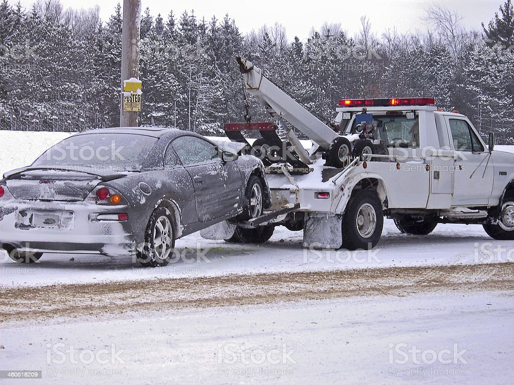 tow truck towing car stock photo