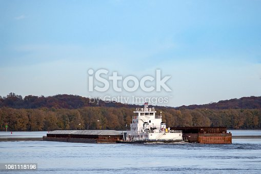 Towboat and barges on the Mississippi River at Muscatine, Iowa, USA.