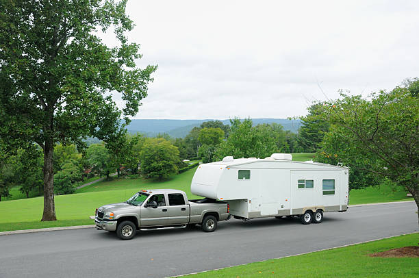 Towed recreational vehicle in mountains stock photo