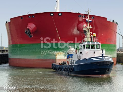 Container ship being towed into the sluices