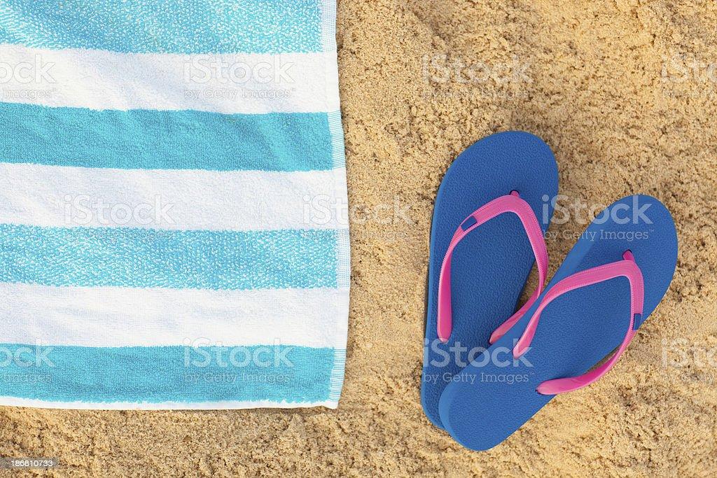 beach towel on beach. Delighful Towel Towel And Blue Sandals On Beach Background Stock Photo On Beach P