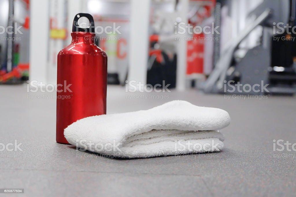 towel and bottle of red water in sport club zbiór zdjęć royalty-free