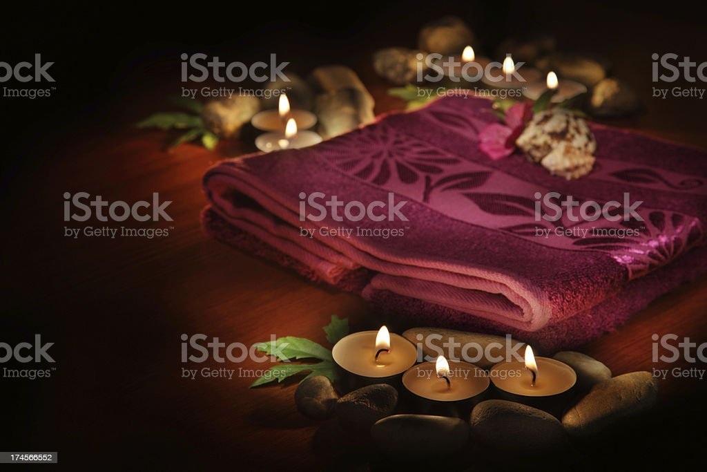 Towel, aromatic candles and other spa objects royalty-free stock photo