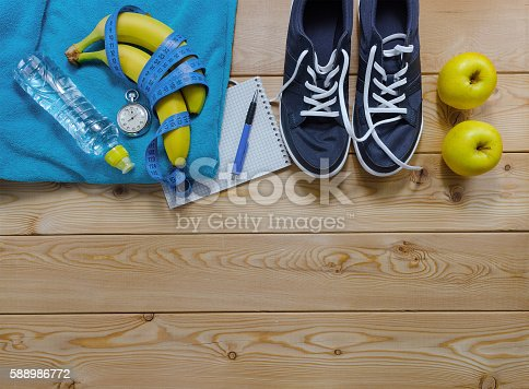 istock towel bottle of water measure tape fruit and a stopwatch. 588986772