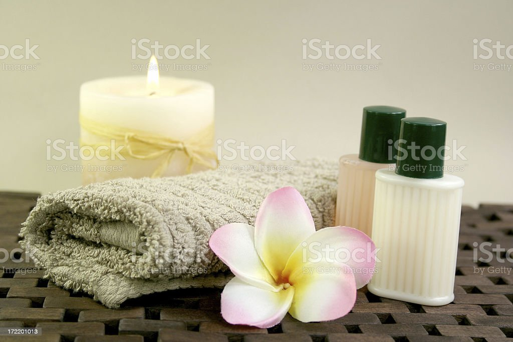 towel, candle, frangipanis and spa products royalty-free stock photo