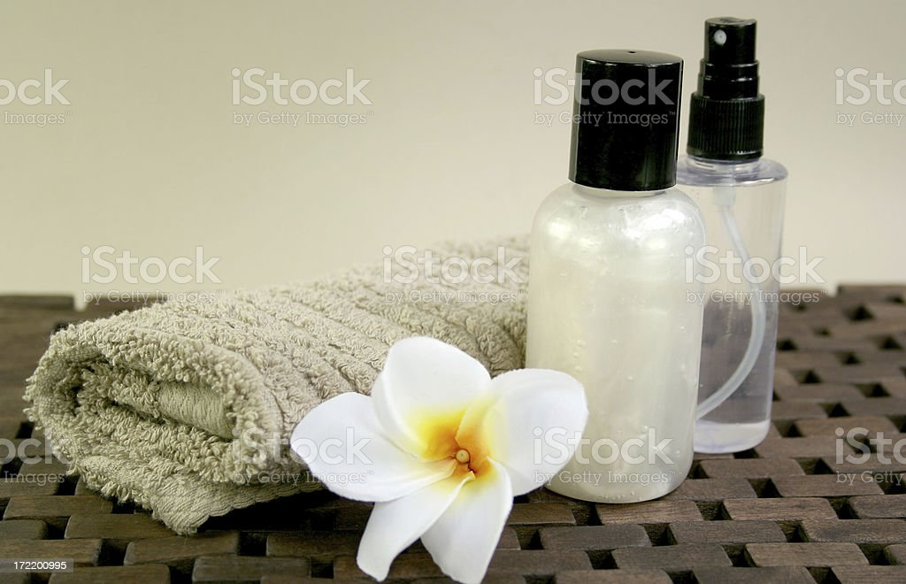 towel, frangipanis and spa products royalty-free stock photo
