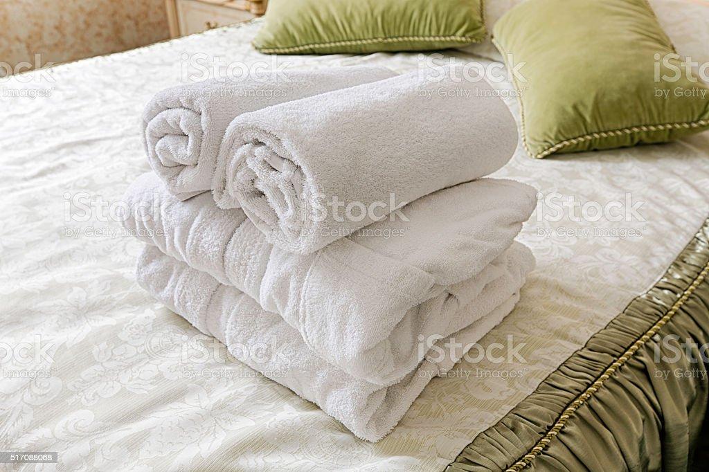 Towels in Hotel room. Closeup of hotel bedroom towels, selective...