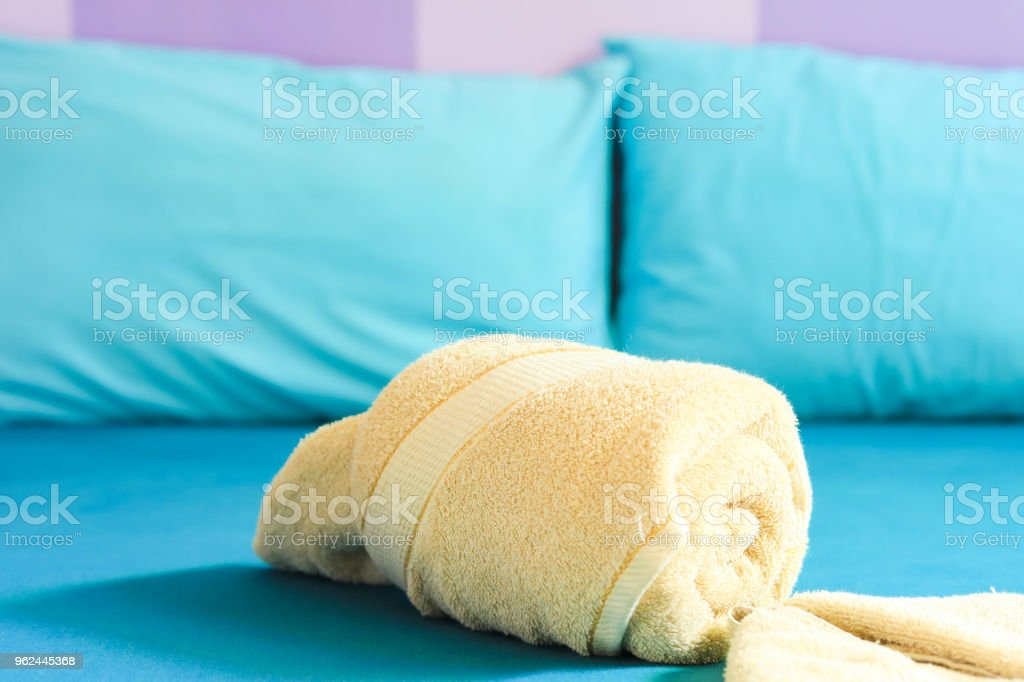 towel on the bed in the bedroom stock photo