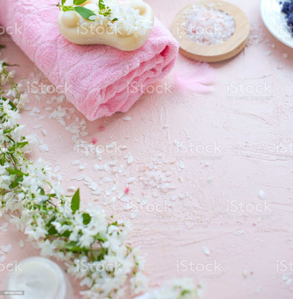 SPA. Towel, sea salt and soap. Pink background and flowers. Place for text. - Royalty-free Archival Stock Photo