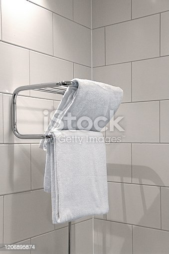 Towel warmer in bathroom heater suitable for both drying and heating towels