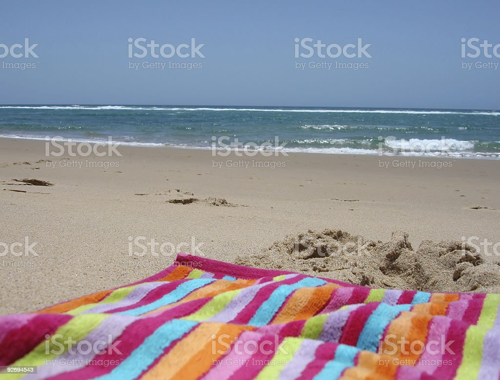 Towel with beach in background stock photo