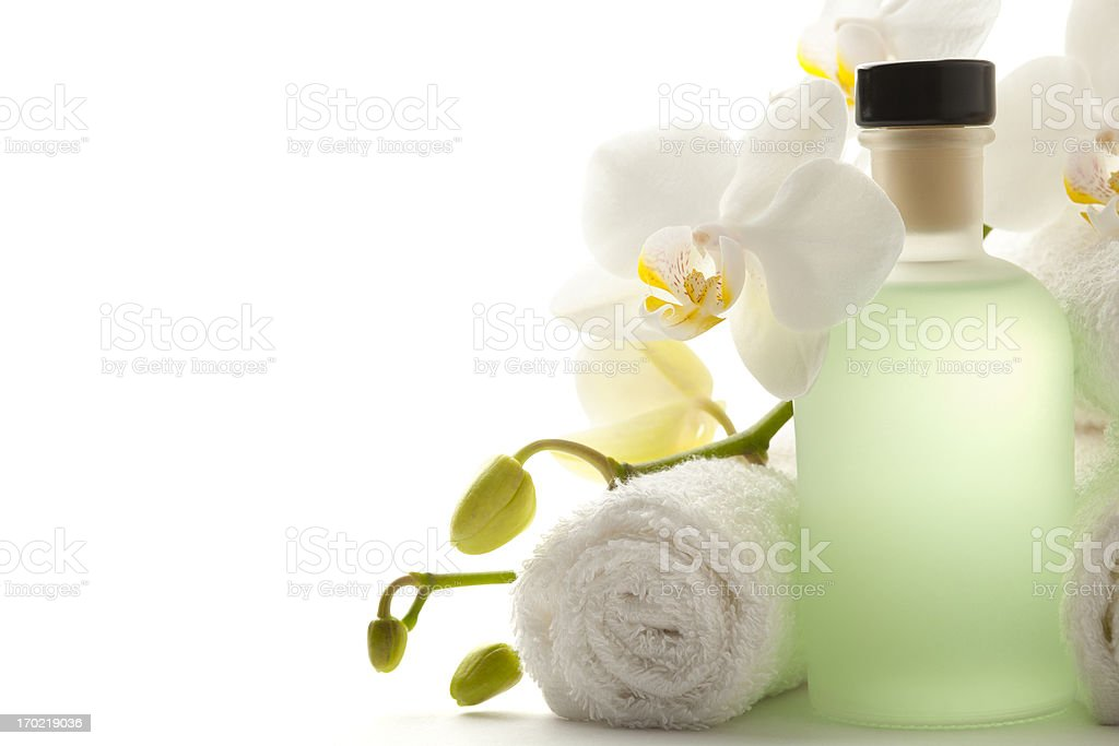 Towel with orchid and bottle royalty-free stock photo