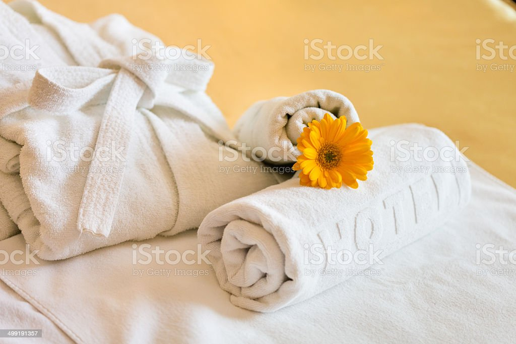 Towels and bathrobe in hotel room stock photo