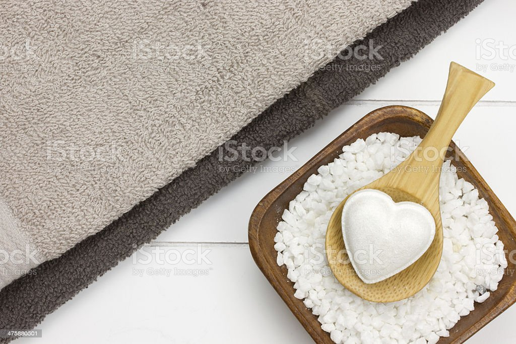towels and bowl filled with white bath salt royalty-free stock photo