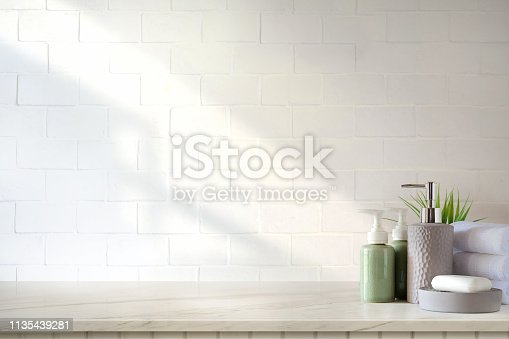 istock Towels and ceramics shampoo or soap on top marble table in bathroom background. 1135439281