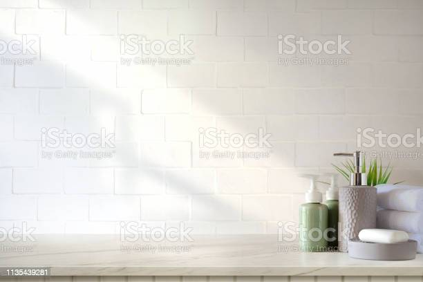 Towels and ceramics shampoo or soap on top marble table in bathroom picture id1135439281?b=1&k=6&m=1135439281&s=612x612&h=gzws8qcvmze16i7z6h0izo kpb5m68mhtkjwvu59fue=