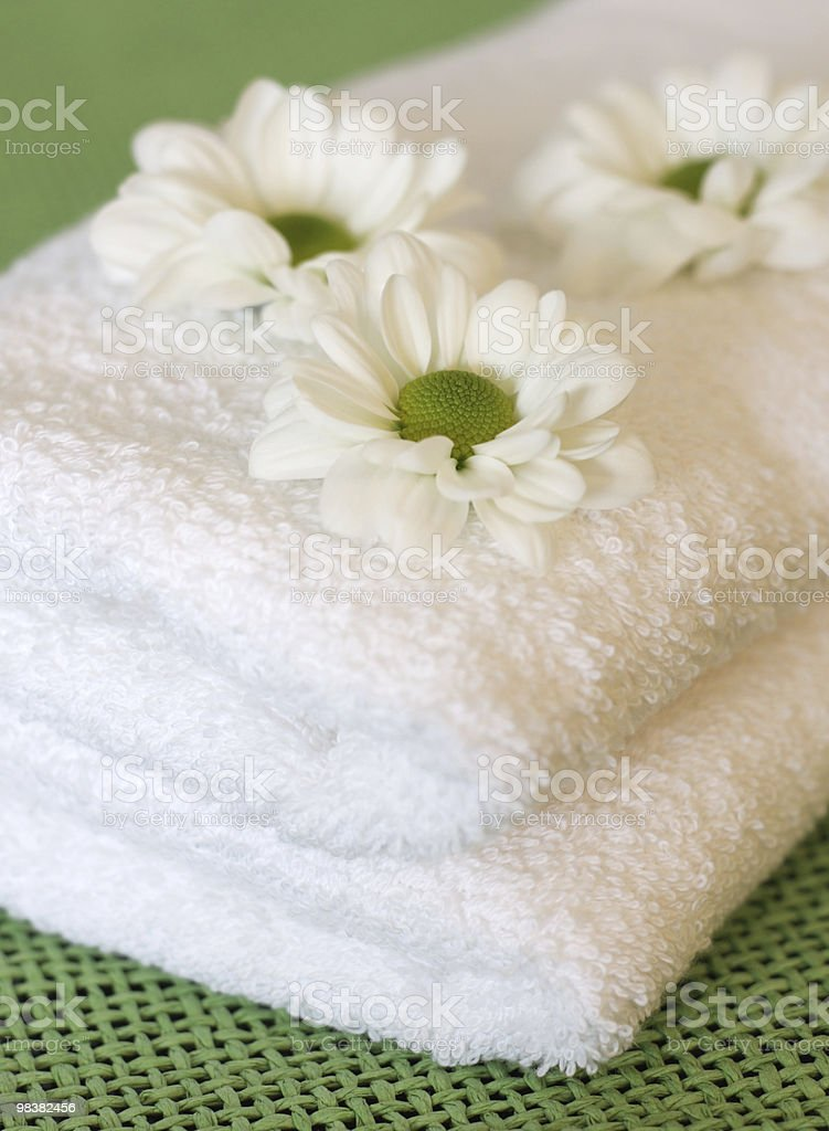 Towels and daisy flowers royalty-free stock photo