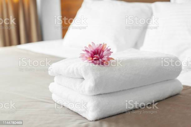 Towels and flower on bed in hotel room picture id1144780469?b=1&k=6&m=1144780469&s=612x612&h=e rupwuqrsvlhloo2ng94uf8icfvhe2ral2xdtafhd8=