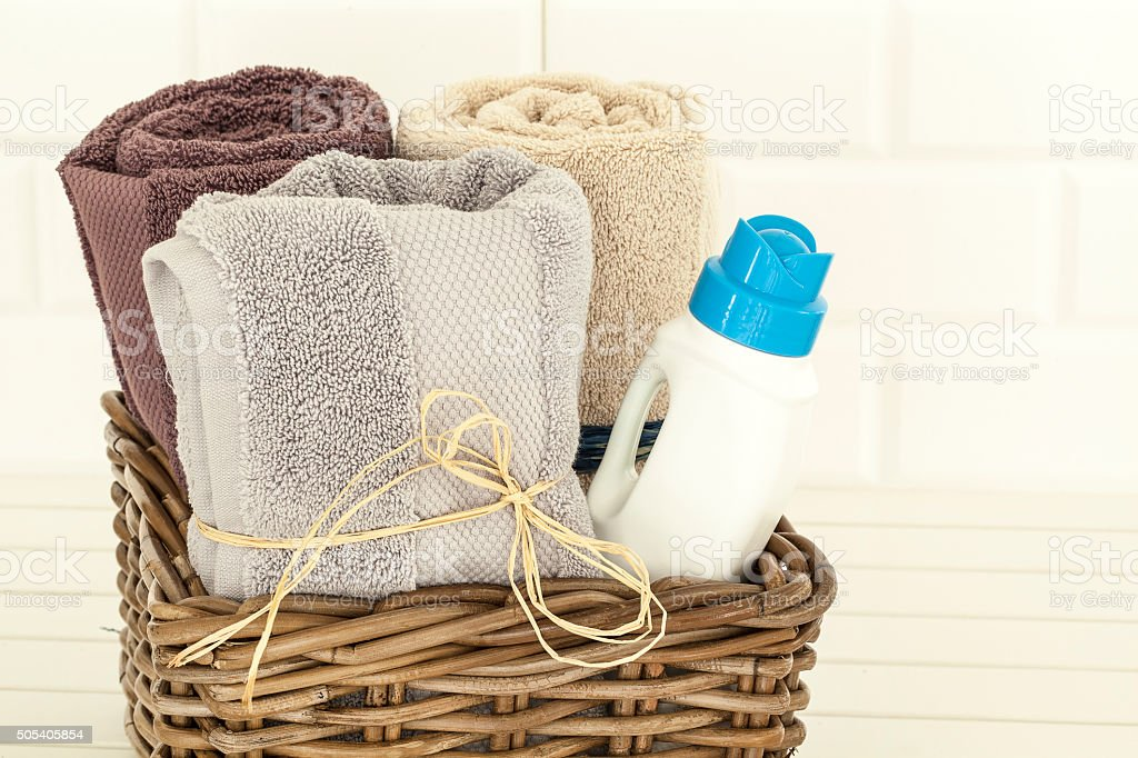 Towels and liquid laundry detergent stock photo