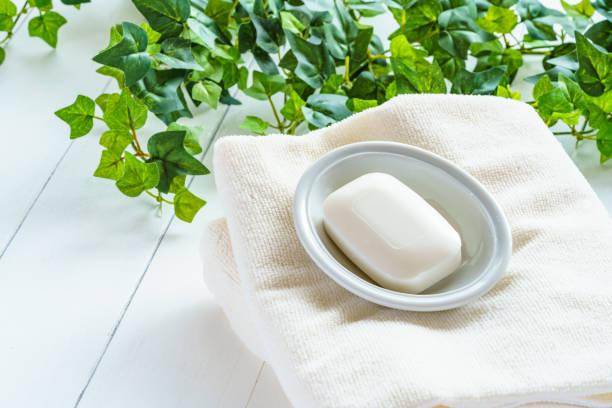 towels and soap - saponetta foto e immagini stock